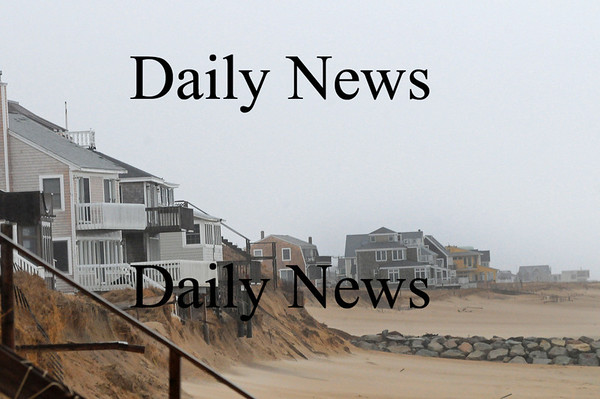 Newbury: The homes along Annapolis Way are in a precarious position as the high tides, heavy rain and strong winds have seriously erroded the dunes in front of the homes. Photo by Ben Laing/Staff Photo