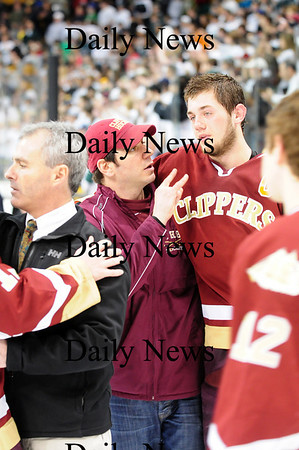 Boston: Coach Jed Beaparlant consoles senior Derek Freeman after the Clippers fell to Canton 4-2 at the TD Garden on Sunday. Photo by Ben Laing/Staff Photo