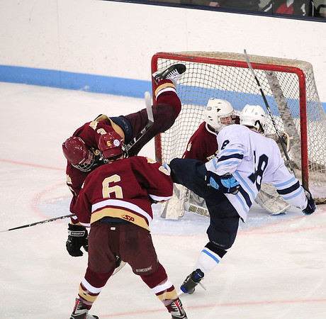 Chelmsford: Newburyport's Kyle McElroy (3) collides with Wilmington's Edward Barrasso (18) in front of the Clippers' net during Monday night's game in Chelmsford. Newburyport would hand Wilmington their first loss of the year, eliminating them from the state tournament, 3-1. Photo by Ben Laing/Staff Photo