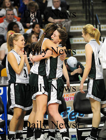 Boston: Erin McNamara, right, and Ashley Viselli share a hug after leaving Tuesday's game late in the fourth quarter. The pair helped lead the Sachems to a 62-37 win over Archbishop Williams at the TD Garden in Boston. Photo by Ben Laing/Staff Photo