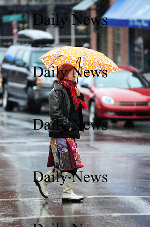 Newburyport: Erika Marqurdt of Newburyport crosses State Street Monday afternoon, while shopping downtown in the rain. Photo by Ben Laing/Staff Photo