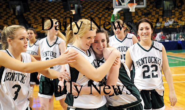 Boston: Holly Jacobsons and Erin McNamara share a hug after defeating Archbishop Williams 62-37 Tuesday at the TD Garden in Boston. Photo by Ben Laing/Staff Photo