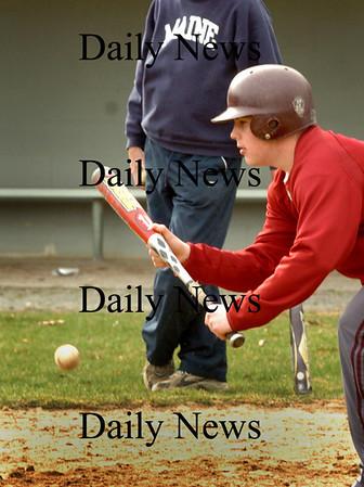 Newburyport: John Gurczack bunts during Newburyport High baseball practice yesterday afternoon. Bryan Eaton/Staff Photo