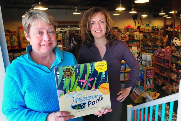 Newburyport: Patti Marsh, left, creator of the game Treasure Pools with designer Patti McCarthy. Bryan Eaton/Staff Photo