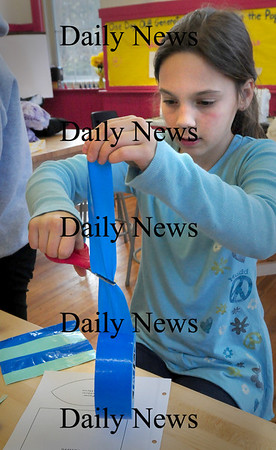 Newburyport: Michelle Thibault, 11, tries to cut some uncooperative duct tape while making a purse Tuesday afternoon. She was in craft free time at the Drop-In Center at the Kelley School. Bryan Eaton/Staff Photo