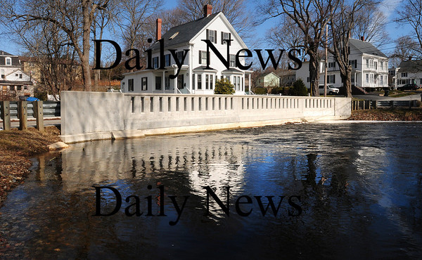 Amesbury: The Powow River left no headroom as it passed under the Thompson Street Bridge in Amesbury late yesterday morning. Bryan Eaton/Staff Photo