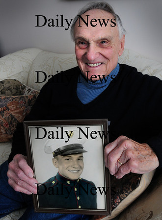 Newburyort: Frank DeZenzo with a portrait of him at 17 years old when he joined the Marines Corp during World War II. Bryan Eaton/Staff Photo