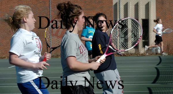 Amesbury: Amesbury High girls tennis team go through drills yesterday afternoon as spring sports gets underway. Bryan Eaton/Staff Photo