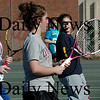 Amesbury: Amesbury High girls tennis team go through drills yesterday afternoon as spring sports gets underway. Bryan Eaton/Staff Photo
