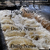 Amesbury: The Powow River surges over the dam at Amesbury's Upper Millyard yesterday afternoon. Bryan Eaton/Staff Photo