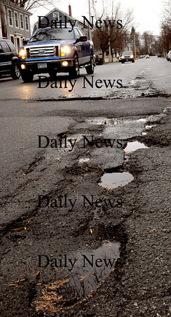 Newburyport: Potholes have made their annual appearance, here on Kent Street in Newburyport, though highway crews have been held up clearing  from the windstorm two weeks ago. Bryan Eaton/Staff Photo