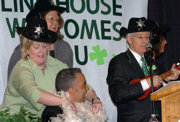 Newburport: Newburyport Chamber President Ann Ormond puts a boa around Sheriff Frank Cousins as she and the rest of Charlie Cullen's back-up singers joke around. Bryan Eaton/Staff Photo