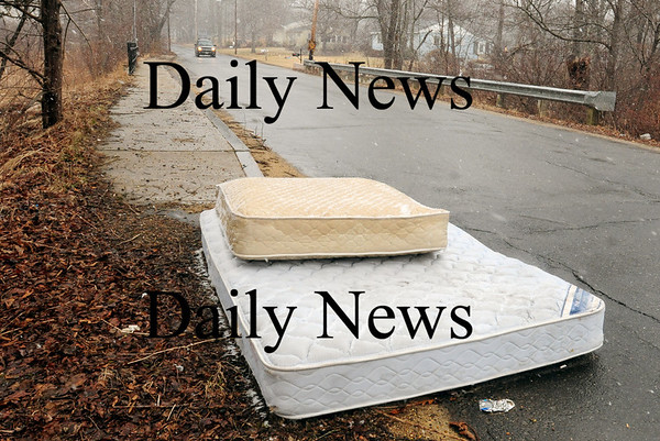 Salisbury: Two mattresses were dumped right on the roadway on Forest Road near Smallpox Brook in Salisbury. Bryan Eaton/Staff Photo