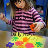 Newburyport: Hollis Ellrott, 5, uses sponges in the shape of different flowers dipped in paint to make spring placemats Wednesday morning. She was in Erin Curtis' pre-kindergarten class at the Brown School in Newburyport. Bryan Eaton/Staff Photo