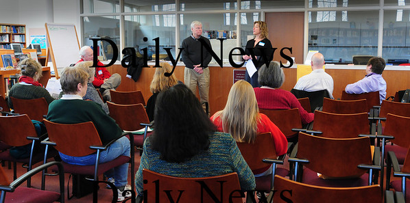 Newburyport: Veteran's agent Kevin Hunt, left, and Hailey Klein, a member of Mayor Holaday's social services transition team, speak to citizens in Newburyport High's library. Different city boards, including planning and schools met with residents to discuss various issues at the mayor's public forum on Saturday. Bryan Eaton/Staff Photo