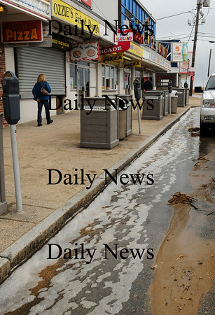 Salisbury: People trying to get pizza at Salisbury Beach late yeserday morning had to cross over a small stream of tidewater running down the roadway. Bryan Eaton/Staff Photo