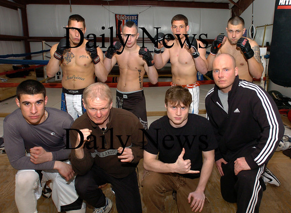 Salisbury: Global fight league coaches/trainors, front, from left, Ruben Gonzalez, Dan Green, Josh Webster and Bill Harrocks. Fighters, back, from left, Nathan Boyer, Josh Bourque, Rob West and Myles O'Keefe. Bryan Eaton/Staff Photo