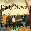 Newburyport: Teens stretch their arms as they warm up for a yoga class taught by Newburyport instructor Candy Blaxter on Tuesday afternoon. The activity is one of many for the students at the Teen Drop-In Center at the Kelley School. Bryan Eaton/Staff Photo