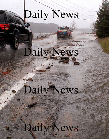 Amesbury: A torrent of water runs along Merrimac Street in Amesbury  just west of Hatter's Point. Bryan Eaton/Staff Photo