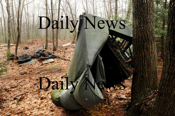 Salisbury: A bunch of tires and one of several pieces of furniture dumped on a tote road that runs off of Seabrook Road in Salisbury. Bryan Eaton/Staff Photo