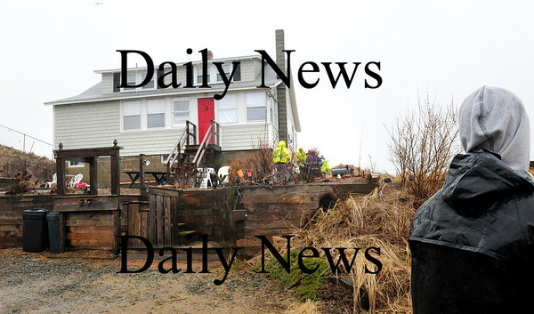 Newbury: Newbury officials were on the scene at this home at 27 Annapolis Way which they feared could have tumbled into the ocean during yesterday's high tide. Bryan Eaton/Staff Photo