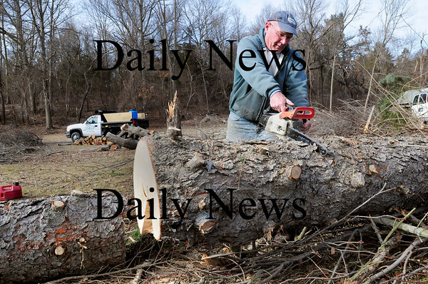 Newbury: Mike Sarette of Parker River Landscaping, which his son, James, owns, cuts trees and limbs along High Road in Newbury at the base of Little Old Town Hill. That area of town was especially hard hit by last week's wind storm. Bryan Eaton/Staff Photo