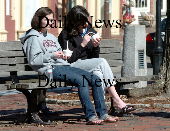 Newburyport: Kelsey Crowley, left, and Leah Campbell, both 16, take in yesterday's sunshine eating some ice cream from Simply Sweet in Market Square in Newburyport. Bryan Eaton/Staff Photo