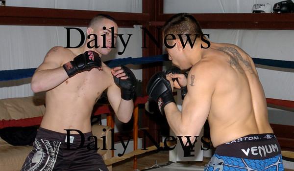 Salisbury: Josh Bourque, left, spars with Nathan Boyer. Bryan Eaton/Staff Photo