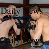 Salisbury: Josh Bourque, left, spars with Nathan Boyer. Bryan Eaton/Staff Photo