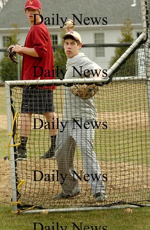 Newburyport: Kevin Crossman pitches during practice yesterday at Newburyport's Lower Field. Bryan Eaton/Staff Photo