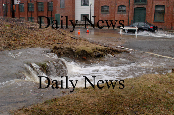 Amesbury: Water from Bailey's Pond in Amesbury is spilling out onto Merrimac Street across from Hatter's Point complex. Bryan Eaton/Staff Photo
