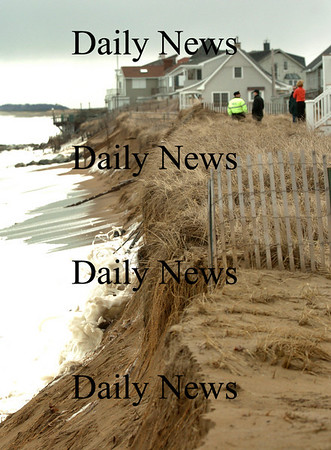 Newbury: Officials check out some erosion about 150 yards south of Plum Island Center yesterday morning. Bryan Eaton/Staff Photo