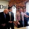 Amesbury: Joseph Fahey, Amesbury's ecocomic development chief, shows plans of the Lower Millyard and future transportation center to Secretary of the Department of Transportation Jeffrey B. Mullan, left, along with Sen. Steven Baddour, Rep. Michael Costello, and Mayor Thatcher Kezer, right. Bryan Eaton/Staff Photo