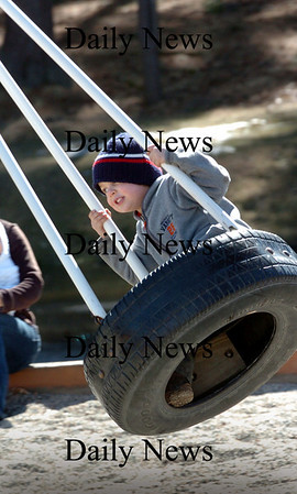 Amesbury: Dyson Morse, 4, of South Hampton enjoyed Saturday's nice weather as his dad, Brian, pushed him around on the tire swing at Amesbury Town Park. Bryan Eaton/Staff Photo