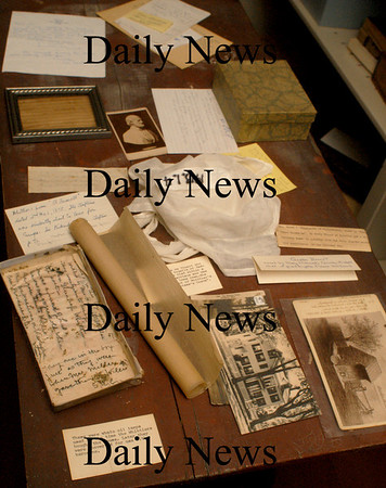 Amesbury: Artifacts are set out to dry in the Whittier Home in Amesbury. Bryan Eaton/Staff Photo
