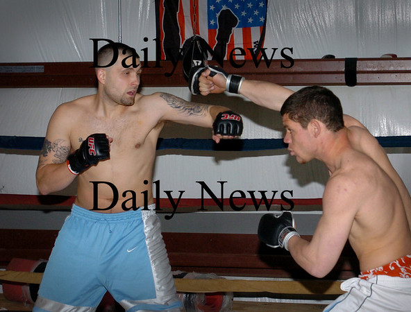 Salisbury: Myles O'Keefe, 170 weight, left, spars with Rob West, 155 weight. Bryan Eaton/Staff Photo