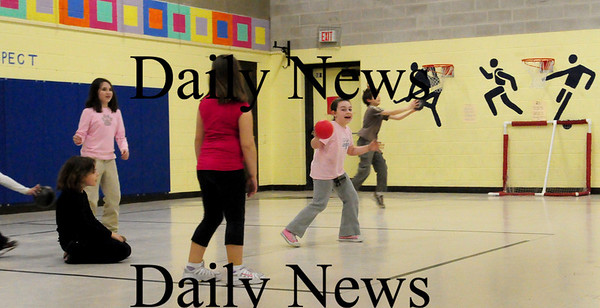 """Amesbury: Children play """"silent dodgeball"""" in the gym of Amesbury Elementary Schoo during Amesbury Recreational Department's after school program moved their physical activities indoors due to the wet weather. Bryan Eaton/Staff Photo"""