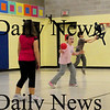 "Amesbury: Children play ""silent dodgeball"" in the gym of Amesbury Elementary Schoo during Amesbury Recreational Department's after school program moved their physical activities indoors due to the wet weather. Bryan Eaton/Staff Photo"