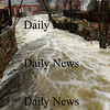 Amesbury: The raging Powow River flows through Amesbury's Upper Millyard late Monday morning. Bryan Eaton/Staff Photo