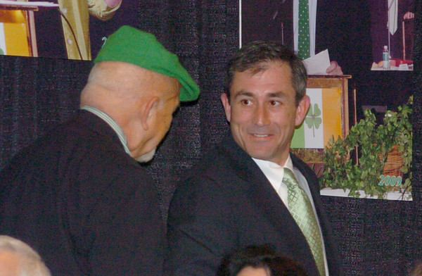 """Newburyport: Link House Executive Director Nick Costello, left, congratulates William """"Bill"""" Buckley on being named this year's Irishman of the Year at Friday's St. Patrick's Day Luncheon. Bryan Eaton/Staff Photo"""