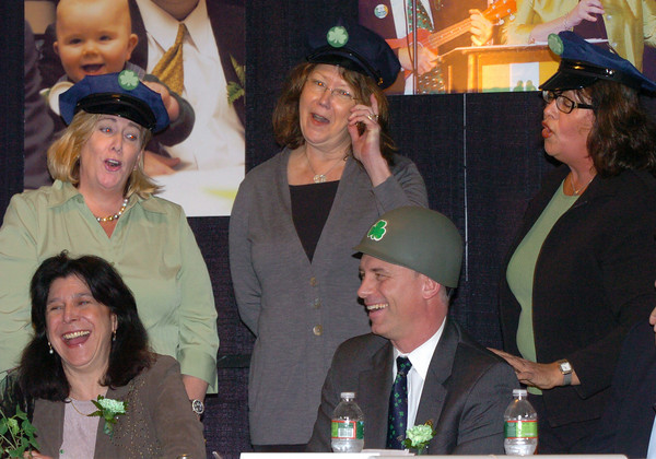"Newburyport: Newburyport Mayor Donna Holaday and Amesbury Mayor Thatcher Kezer laugh as the ""Back-Up Singers"" from left, Ann Ormond, Cindy Johnson and Esther Sayer, sing ""Soldier Boy"" referencing Kezer's time in the military. Bryan Eaton/Staff Photo"