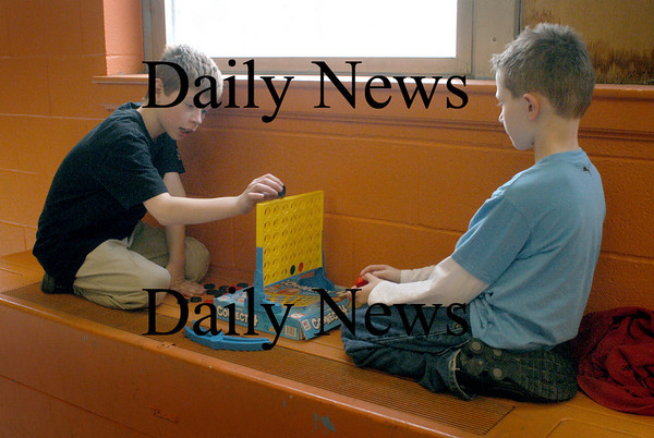 Salisbury: The adjacent field was too wet for outdoor activities at the Boys and Girls Club in Salisbury on Wednesday afternoon. Miles O'Grady, left, 9, and Daniel White, 8, both of Salisbury found a quiet spot to play Connect 4, a 3-D kind of checkers game. Bryan Eaton/Staff Photo