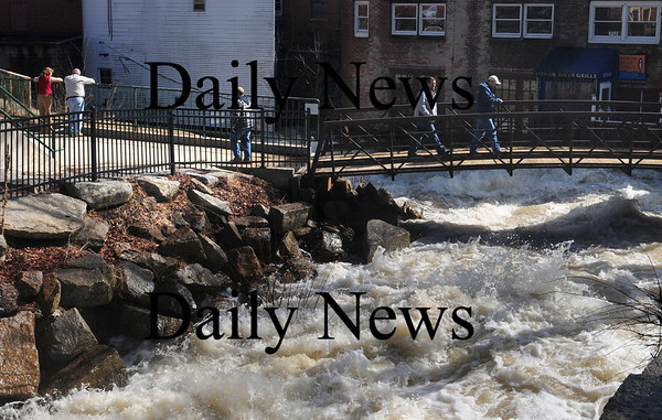 Amesbury: Dozens of people were checking out the raging Powow River in Amesbury's Upper Millyard yesterday morning. Bryan Eaton/Staff Photo