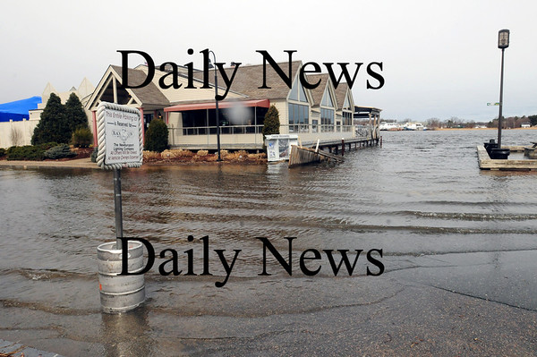 Newburyport: The parking lot at the Black Cow was covered during high tide late yesterday morning. Bryan Eaton/Staff Photo