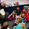 "Amesbury: State Rep. Michael Costello reads ""The Twigley's Tree"" which his mother, Cynthia, required all her sons to read, to a class at Cashman Elementary School on Tuesday morning. He was there for ""Read Across America"" which bring people in the community in to read for students. Bryan Eaton/Staff Photo"