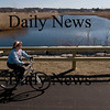 Salisbury: Mary Ann Fitzgerald bikes along the Rail Trail in Salisbury. Bryan Eaton/Staff Photo