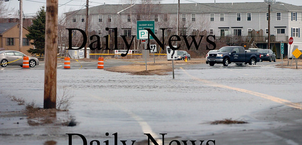 Salisbury: Traffic on Route 1A (Beach Road) in Salisbury was detoured around Old County Road as high tide spilled onto the roadway near the entrance to the state reservation. Bryan Eaton/Staff Photo