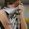 Worchester: Pentucket's Erin McNamara covers her face after the teams loss in the  State chamionship game against Lee Saturday at the DCU Center in Worchester. Jim Vaiknoras/Staff photo