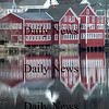 Amesbury: The Lowell's Boat Shop in Amesbury is reflected in the calm waters of the Merrimack River Friday morning. Jim Vaiknoras/Staff photo