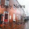 Newburyport: A man huddles under his umbrella as he hurries through Market Square in Newburyport in teh rain Sunday morning. Jim Vaiknoras/Staff photo